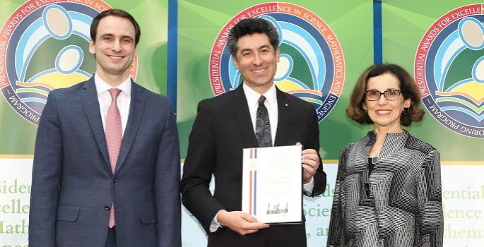 Stassun (center) with NSF Director France Cordova and White House official. photo courtesy of the National Science Foundation