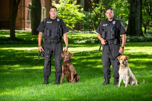 Brutus and handler Sgt. John Oliver (left) and Dyno and handler Lt. Jason Bates (right). (Joe Howell/Vanderbilt)
