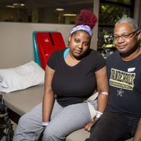 "Shantia ""Tia"" Waggoner and her father Ray at Vanderbilt Stallworth Rehabilitation Hospital in late May. About a month earlier, she was one of those injured in a mass shooting at the Antioch Waffle House, which killed four people, including Tia's fiancé. Photo by Susan Urmy."