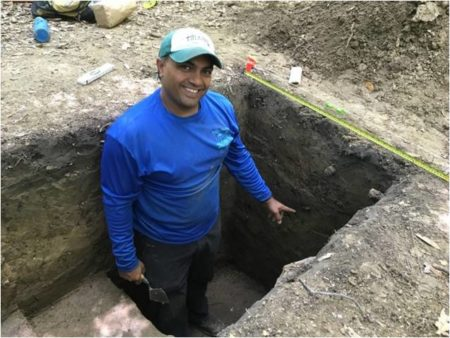 Jayur standing in excavated trench