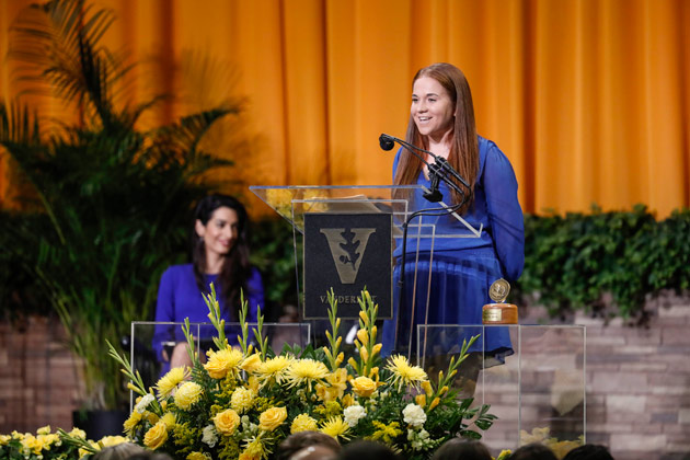 Class of 2018 Senior Class Fund chair Claire Fogarty presents seniors' record-breaking donation during Senior Day activities May 10 in Memorial Gym. (Joe Howell/Vanderbilt)