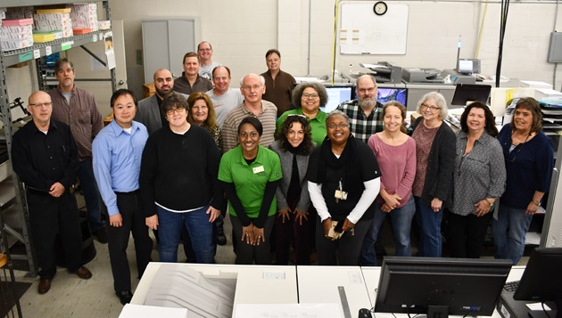 The Printing Services team gathers with EDI staff to celebrate their hard work. (Vanderbilt University)