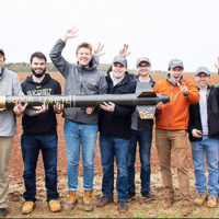 Vanderbilt Design Team celebrating the successful flight and recovery of their rocket SEÑOR COHETE at NASA Student Launch Competition: (L-R) Kurt Lezon, Spencer Kallor, Will Pagano, Dominic Ghilardi, Peyton Fite, Daniel Schneller, Nick Galioto, Taylor Parra, Jered Trujillo, Alex Byrd, Katie Hornbeck and Xavier Williams.