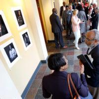 Visitors to the Bishop Joseph Johnson Black Cultural Center get their first looks at Vanderbilt Pioneers portraits. (Steve Green/Vanderbilt)