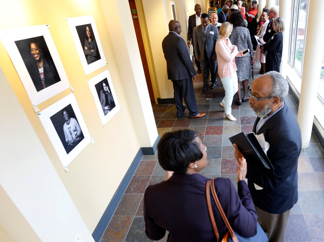 Visitors to the Bishop Joseph Johnson Black Cultural Center get their first looks at Vanderbilt Pioneers portraits. (Steve Green/Vanderbilt)