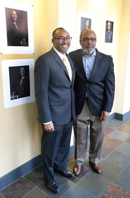 William Robinson, left, associate dean of the School of Engineering, poses with Lucius Outlaw Jr., philosophy professor and the portrait photographer for the Vanderbilt Pioneers series. Outlaw's work was unveiled Tuesday at the Bishop Joseph Johnson Black Culture Center. (Steve Green/Vanderbilt)