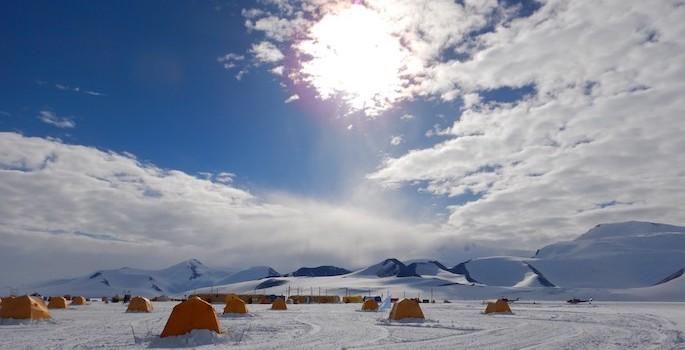 tiny orange tents in the snow