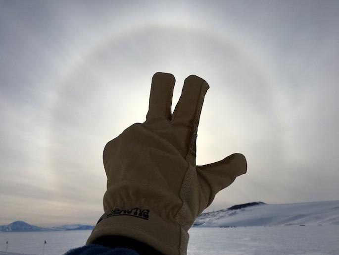 VU handsign against antarctic sun