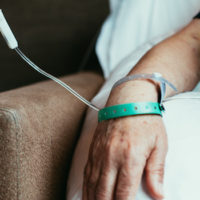 close up of mans arm as he receives chemotherapy infusion