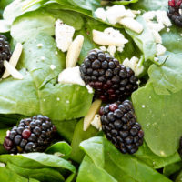 close up of blackberry spinach salad with feta cheese