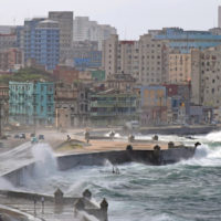 rough waves overtake seawall protecting caribbean city