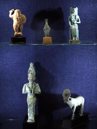 "Ancient Egyptian figures representing various gods and goddesses are on loan from Emeritus Professor Douglas Knight for the ""Cultures in Clay"" exhibition. (Steve Green/Vanderbilt)"