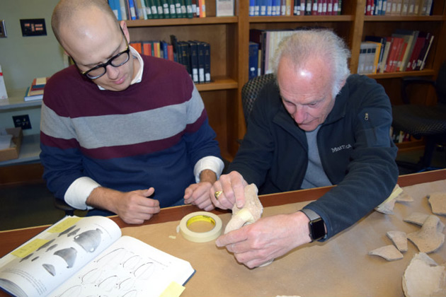 L-r: Jonathan Redding, a doctoral student in religion, and Emeritus Professor Douglas Knight sort through pottery fragments recovered from an archaeological dig at Megiddo. (Vanderbilt University)