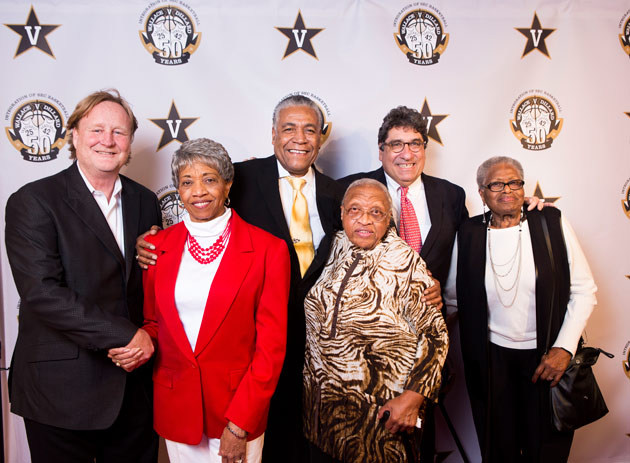 "Filmmaker Rich Gentile, Perry Wallace's teammate and fellow SEC pioneer Godfrey Dillard and Chancellor Nicholas S. Zeppos with Wallace's sisters at the premiere of ""Triumph: The Untold Story of Perry Wallace"" on Dec. 4. (Susan Urmy/Vanderbilt)"