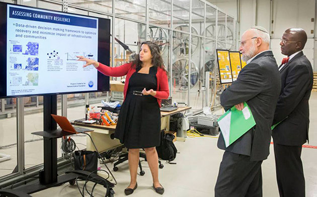 Assistant Professor of Civil and Environmental Engineering Hiba Baroud discusses her research with Alexander Kott and Jaret Riddick of the Army Research Lab. (Vanderbilt University)