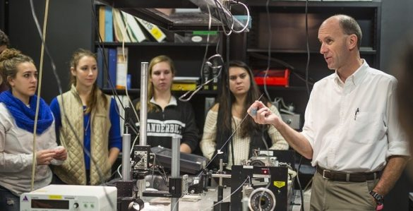 Jansen with students in lab