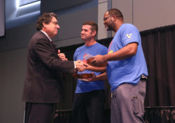 Chancellor Nicholas S. Zeppos presents Facilities' Joey Knight (center) and Jeff Bratton (right) with the Heart and Soul Staff Appreciation Award Nov. 1 at the Student Life Center. (Anne Rayner/Vanderbilt)