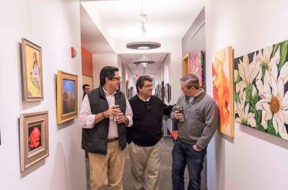 Conéxion Américas co-founder Jose Gonzalez (left) and Tennessee State Sen. Jeff Yarbro (right) join Chancellor Nicholas S. Zeppos on a tour through Casa Azafrán. (John Russell/Vanderbilt)