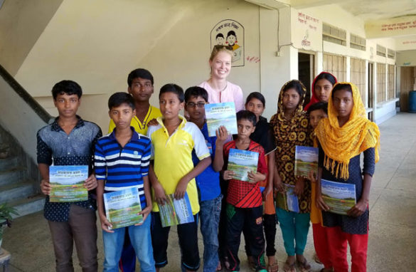 Chelsea Peters poses with students in Bangladesh who received free copies of her book. (Submitted photo/Chelsea Peters)