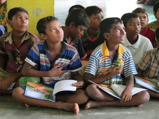 "Students in Bangladesh listen to a classroom lesson based on ""Farzana's Journey."" (Submitted photo/Chelsea Peters)"