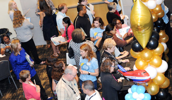 """The airport-themed Flight School Learning Fair featured 12 """"gates"""" where the 800 participants could speak with 75 subject-matter experts about how specific changes will impact them. (Vanderbilt University)"""