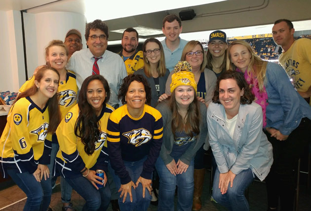 Chancellor Nicholas S. Zeppos and the winners of the #UnitedInGold social media contest at the Nashville Predators' season opener Oct. 10. (Vanderbilt University)