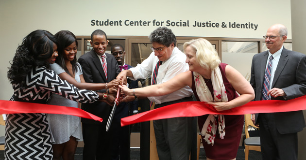 Chancellor Nicholas S. Zeppos and Provost and Vice Chancellor for Academic Affairs Susan R. Wente help cut the ribbon to open Vanderbilt's new Student Center for Social Justice and Identity Sept. 19 at Sarratt Student Center. (Vanderbilt University)