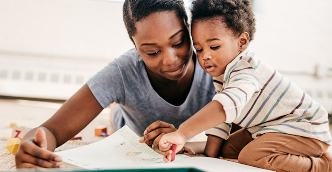african american mother reading to son