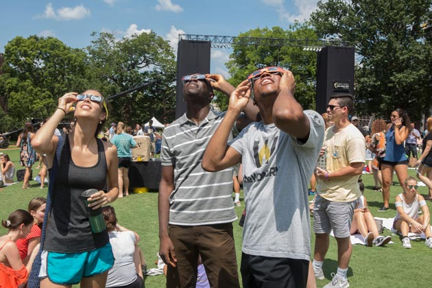 Vanderbilt students view the total solar eclipse on Aug. 21, 2017, from the celebration on Alumni Lawn. (Susan Urmy/Vanderbilt)