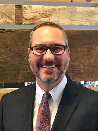 Brian Heuser, faculty director of the Ingram Scholarship Program