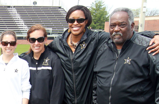 Associate Vice Chancellor for University Affairs and Deputy Athletics Director Candice Storey Lee (second from right) and Vice Chancellor for Athletics and University Affairs and Athletics Director David Williams (far right).