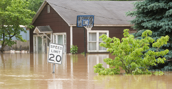 Floodwaters coming halfway up the side of a house