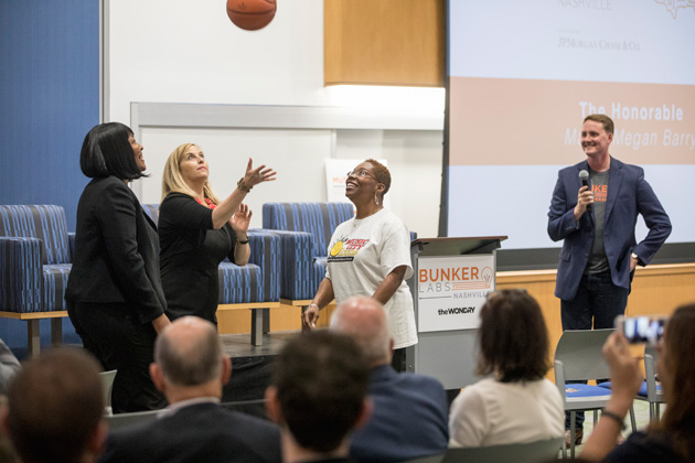 Mayor Megan Barry facilitates a jump ball with Music City Icons founder Renee Bobb (left) at the Muster Across America launch May 24 at the Wond'ry. (John Russell/Vanderbilt)