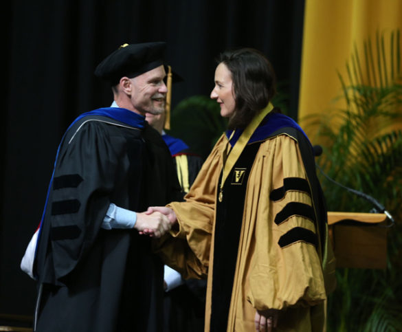 Graduate School Dean Mark Wallace and Founder's Medalist Emily Hennessy. (Joe Howell/Vanderbilt)