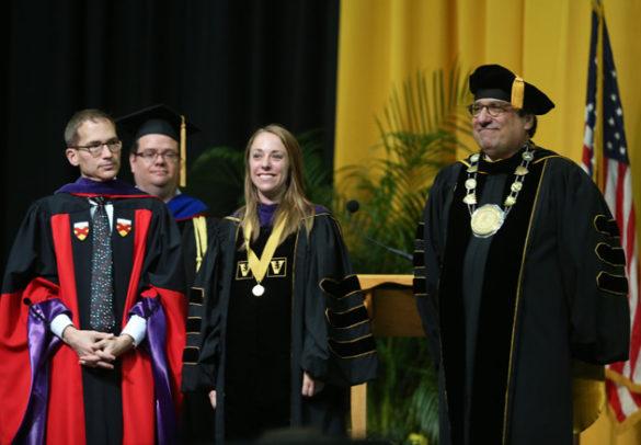 Vanderbilt Law School Dean Chris Guthrie, Founder's Medalist Laura Dolbow and Chancellor Nicholas S. Zeppos. (Joe Howell/Vanderbilt)