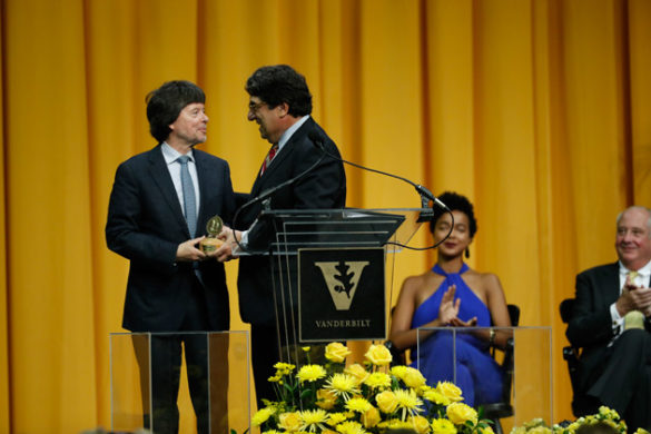 Chancellor Nicholas S. Zeppos awards filmmaker Ken Burns the Nichols-Chancellor's Medal May 11 in Memorial Gym. (Daniel Dubois/Vanderbilt)