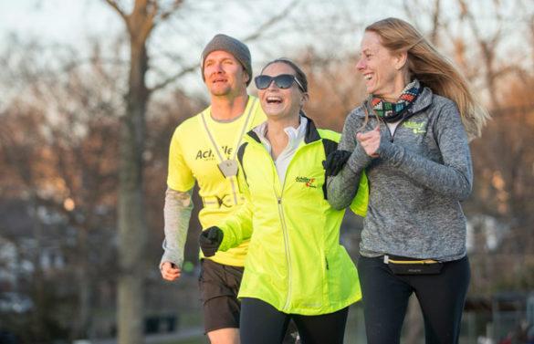 Peabody College senior Stephanie Zundel (center) on a run with her Achilles International training partners Harvey Freeman and Amy Harris. (John Russell/Vanderbilt)