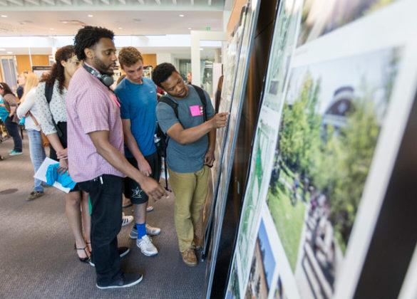 Students look at display boards and give feedback at the FutureVU Expo April 19. (Joe Howell/Vanderbilt)