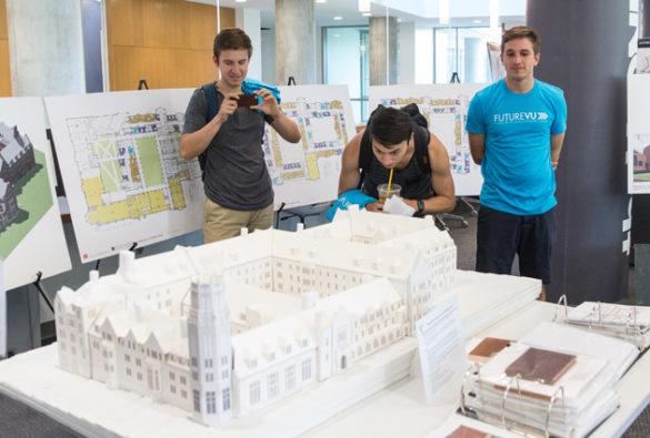 Students look at a 3D model of the residential college being constructed at the former Vanderbilt Barnard site. (Joe Howell/Vanderbilt)