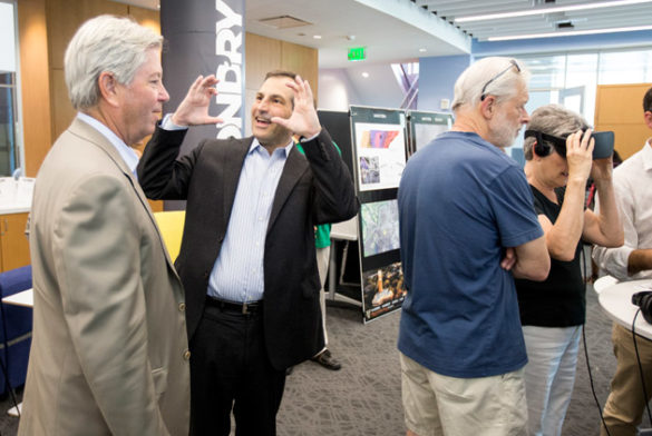 Vice Chancellor for Administration Eric Kopstain (second from left) at the FutureVU Expo's virtual reality viewing station. (Joe Howell/Vanderbilt)