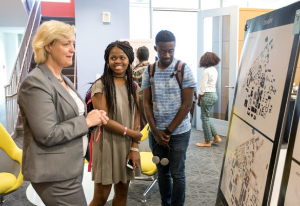 Provost and Vice Chancellor for Academic Affairs Susan R. Wente (left) and students at the FutureVU Expo April 19. (Joe Howell/Vanderbilt)