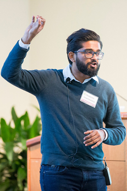 "Neuroscience graduate student Raajaram Gowrishankar delivering his presentation ""Emerging Insights Into Mental Illness - What's Wrong with my Vacuum Cleaner?"" (Susan Urmy/Vanderbilt)"
