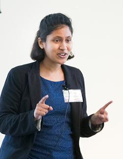 "Biochemistry graduate student Archana Krishnamoorthy delivering her presentation ""Carpe Diem: Seize the Time."" (Susan Urmy/Vanderbilt)"