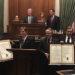 legislators holding up proclamations in chambers