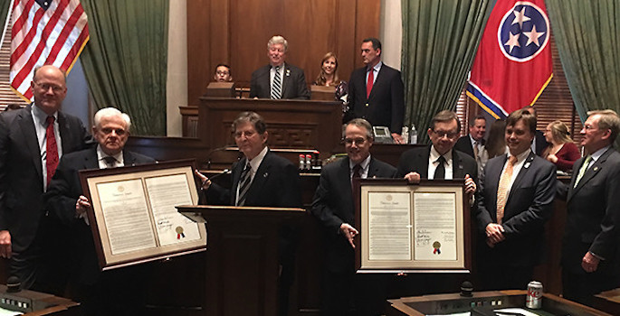 legislators holding up proclamations in chambers