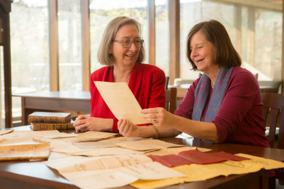 L-r: Valerie Hotchkiss, university librarian, and Paula Covington, Latin American bibliographer, examine rich materials from the J. Leon Herlguera Collection of Colombiana. (Anne Rayner/Vanderbilt University)