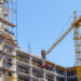 Сonstruction site. Building with crane on the sky background