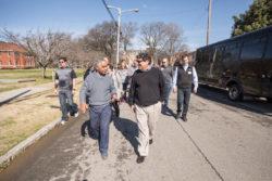 Fisk history professor Reavis Mitchell walks with Chancellor Nicholas S. Zeppos as the group prepares to tour Fisk's Memorial Chapel. (Vanderbilt University)