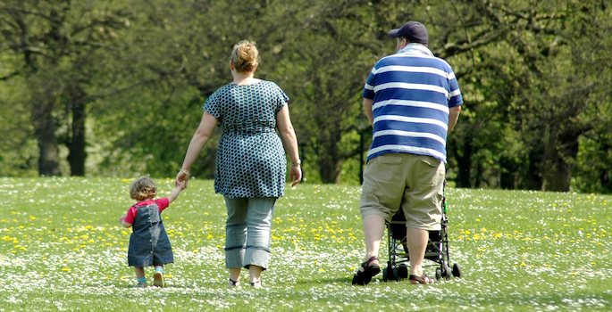 Overweight or obese family in the park