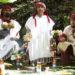Three men in traditional Maya dress